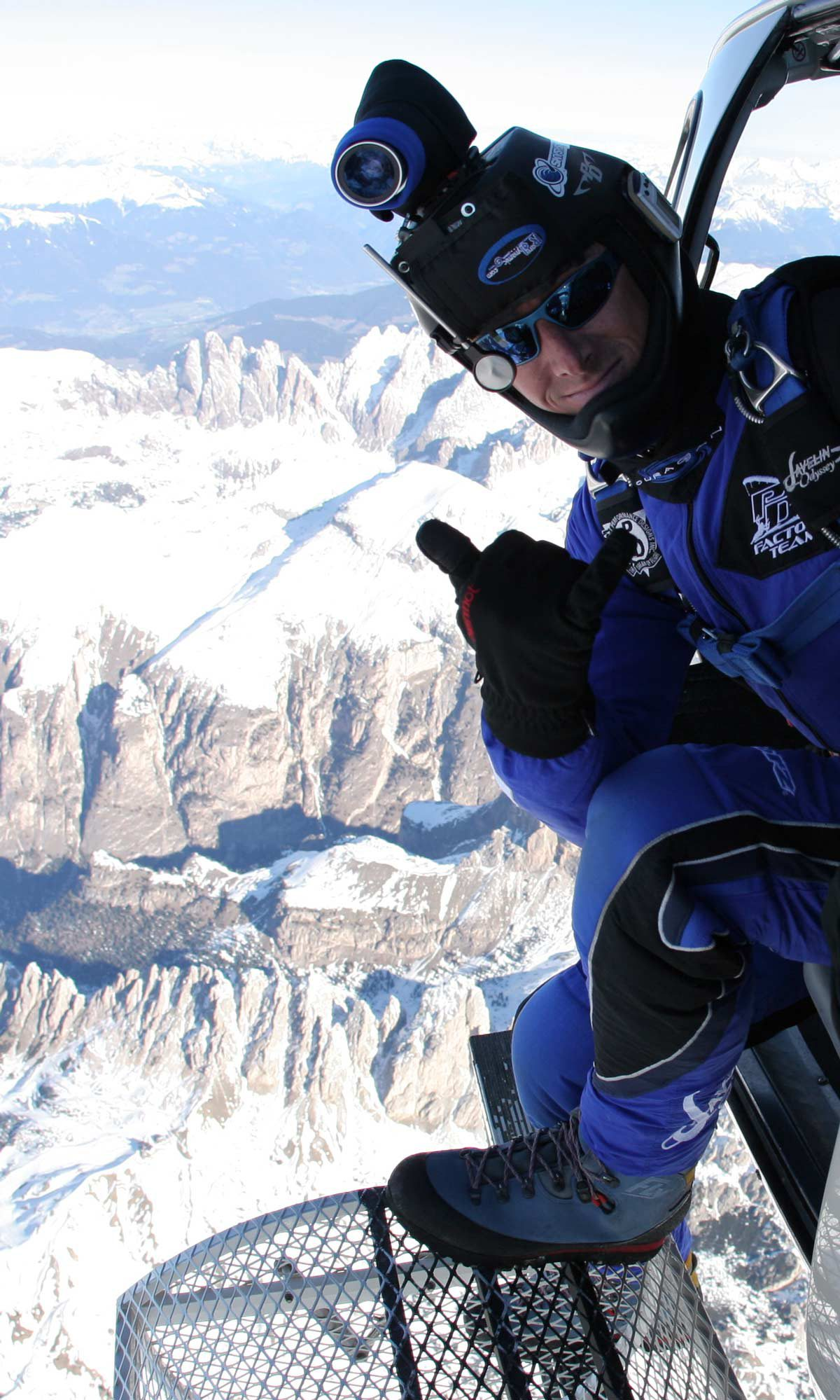 Shannon Pilcher gives thumbs up before exiting to skydive over snowy mountains